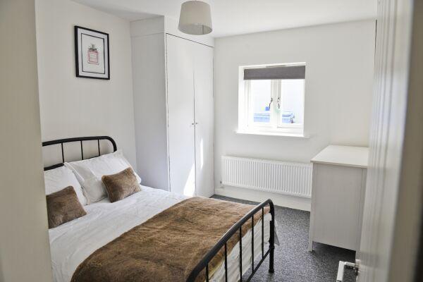 Bedroom with double wardrobe