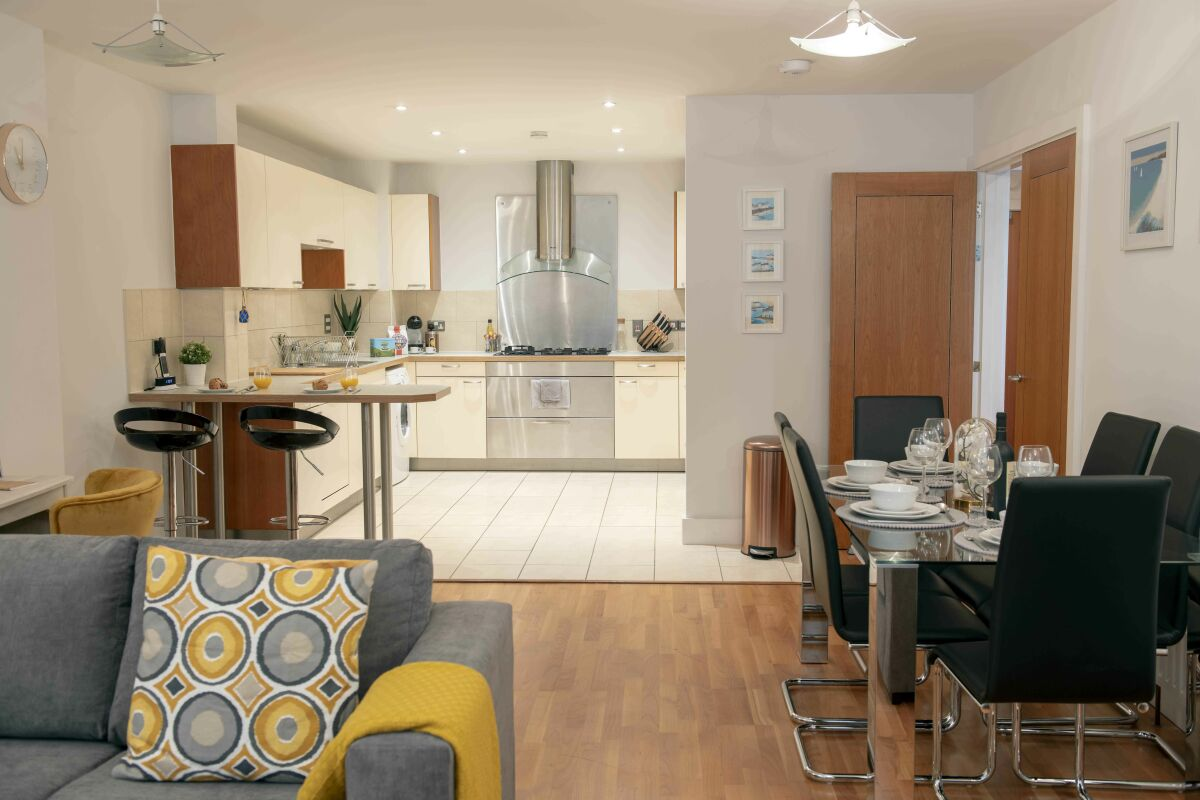 Living room, dining room and open plan kitchen with breakfast bar